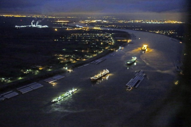 In this aerial photo, river traffic is halted along the Mississippi River between New Orleans and Vacherie, La., due to a barge leaking oil in St. James Parish, La., Sunday, Feb. 23, 2014.  Photo: AP PHOTO/GERALD HERBERT